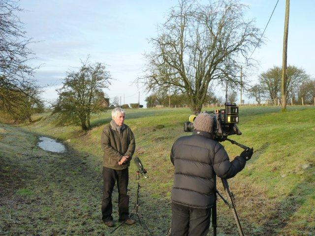 Speaking to camera on a dried up Kennet riverbed in January 2012