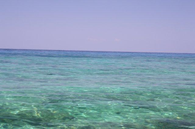 It's a weird thing to be floating over coral reefs in crystal clear water only a few feet deep in the middle of the Indian Ocean