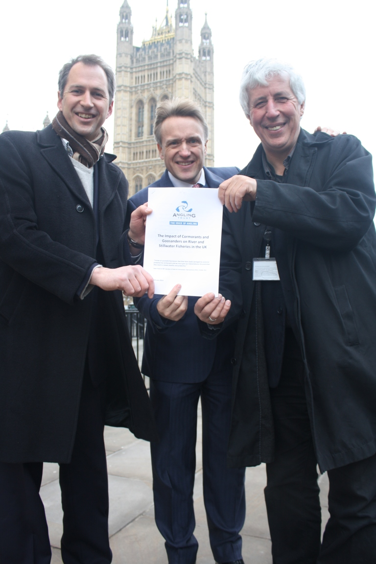Taking the message to Westminster - Mark Lloyd and myself hand a copy of the cormorants dossier to Charles Walker MP, Vice Chair of the All Party Angling Group