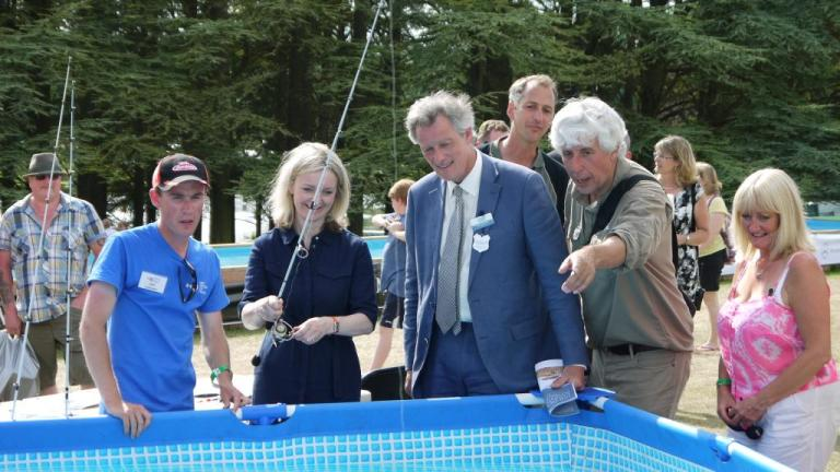 Showing the new Environment Secretary some of the finer points of lure fishing at the Angling trust stand at this year's Game Fair.