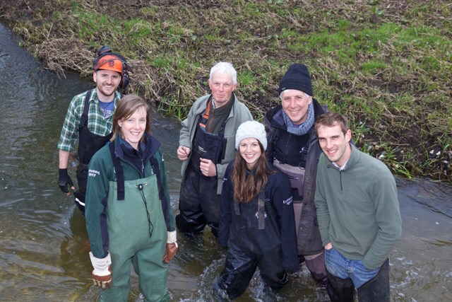 A happy band of habitat volunteers working under the guidance of Andy Thomas from the Wild Trout Trust