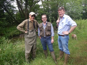 MPs Charles Walker, Owen Smith and Richard Benyon put political differences to one side as they search for trout on a low  River Pang in Berkshire.