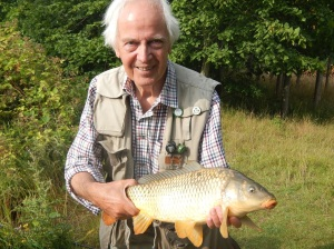 Fly fishing legend Brian Clarke  with a well earned fly caught carp.
