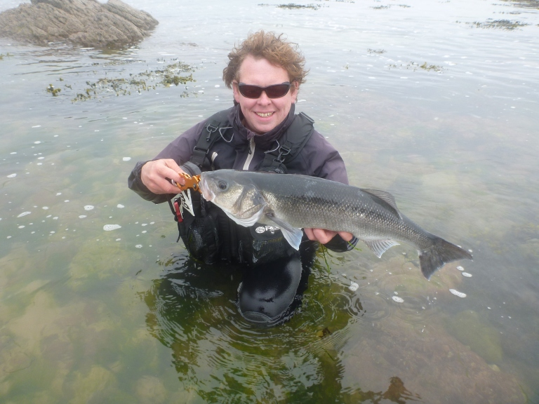 Welsh bass guide Matt Powell with the sort of fish most anglers would want to see returned and allowed to breed